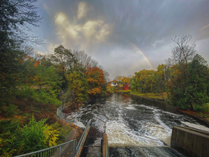 rainbow over the mill dam by Amber Vee Photography