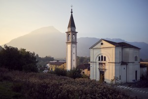 Church in northern italian village during sunset Belluno Italy Europe by Atelier Knox