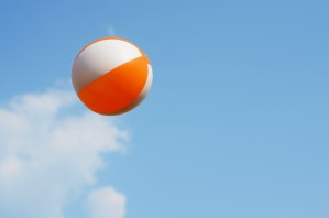 Beach ball on top of cloud by Codrina Miculit