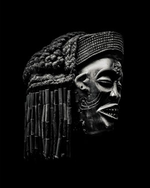 Arfican Head Sculpture Over Black by Daniel Ferreia Leites Ciccarino