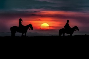 Couple Riding Horses at Nature by Daniel Ferreia Leites Ciccarino