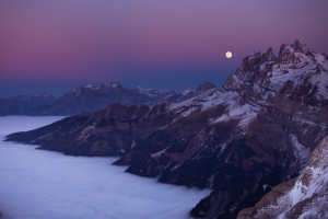 Full Moon over a sea of clouds by Dom Granger Photography