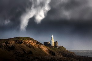 Mumbles lighthouse in the rain by Leighton Collins