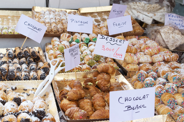Desserts at market in France by Andy LeBlanc