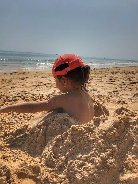 Little girl playing in the sand - Portugal by Anita Varga