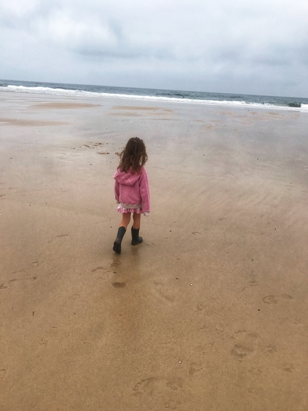 A little girl walking on the beach by Anita Varga