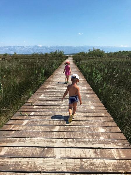Kids on a wooden path Croatia by Anita Varga