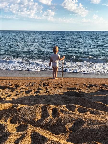 A kid staring into the sea by Anita Varga