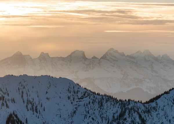 alpine sunsets Valhalla mountain range during a winter sunet by Billy Stevens media