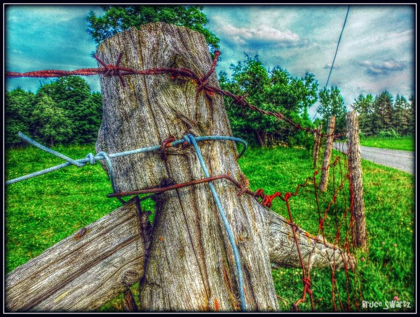 Barb Wired Wooden Post HDR by Bruce Swartz