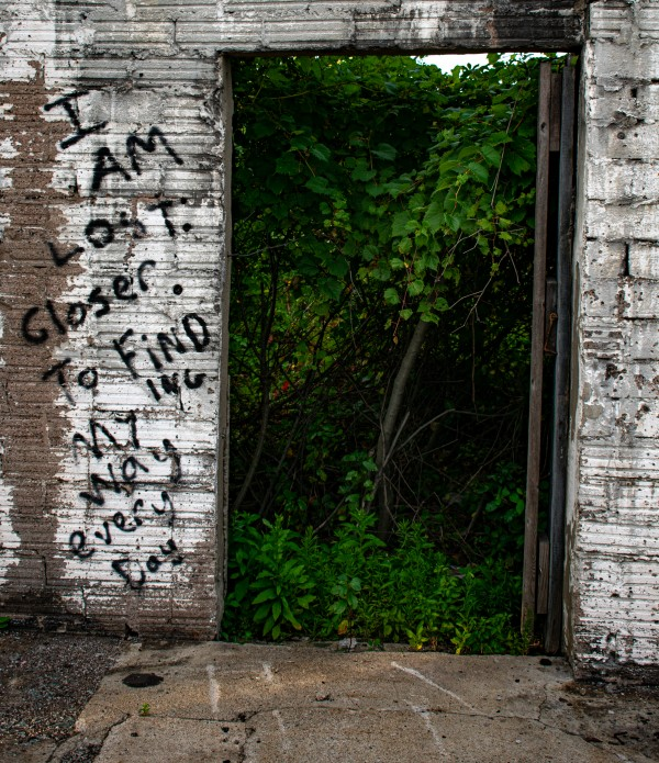 Doorway Graffiti by Cameraman Klein