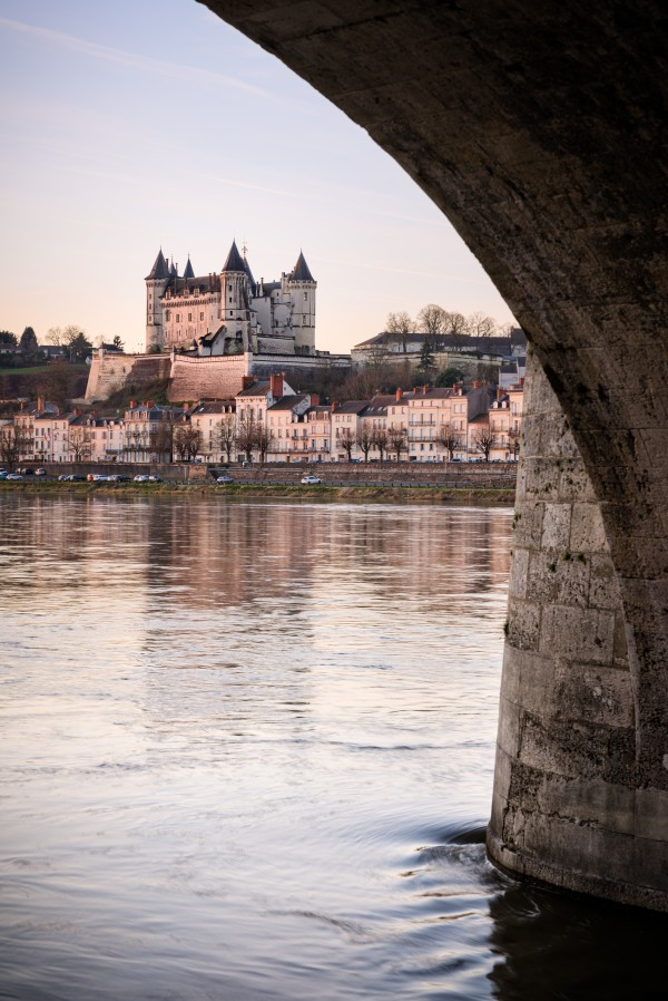 Panorama of Saumur skyline with medieval castle and churches old town centre and bridge along the Loire river France by Em Campos