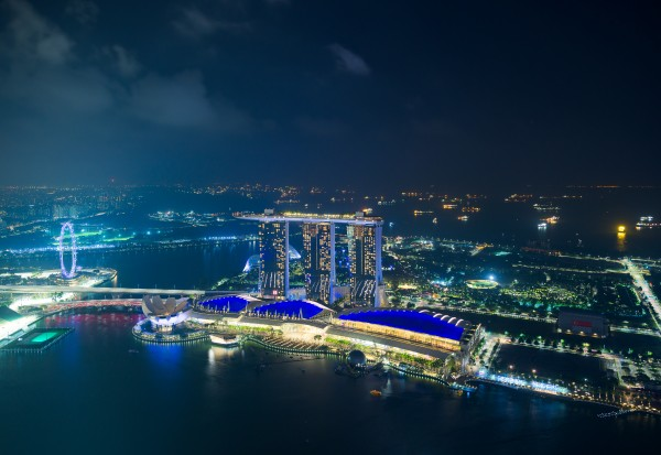 Aerial view of Singapore and Marina Bay Sands at night by Em Campos