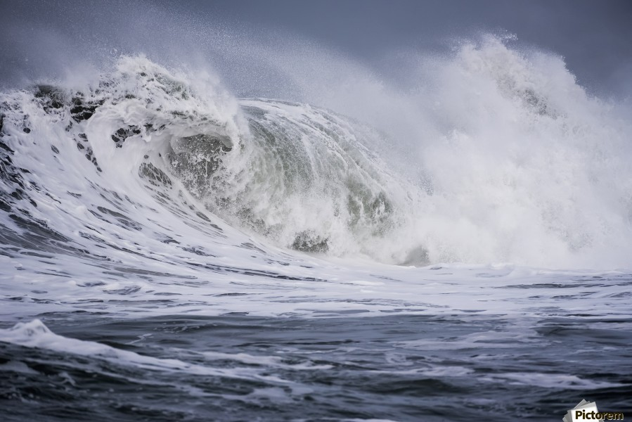A large wave breaks on a stormy morning; Seaside, Oregon, United States of America  Print