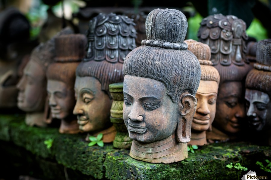 Heads of statues of Buddha are stacked in a terra-cotta factory; Chiang Mai, Thailand  Print