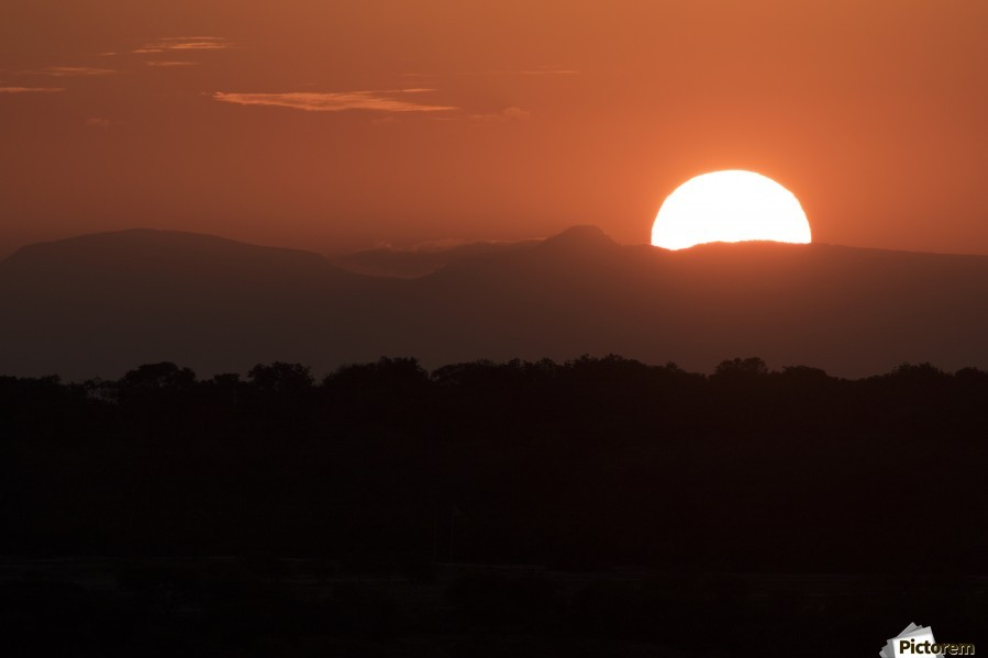 Setting sun overtop of the African landscape; South Africa  Print