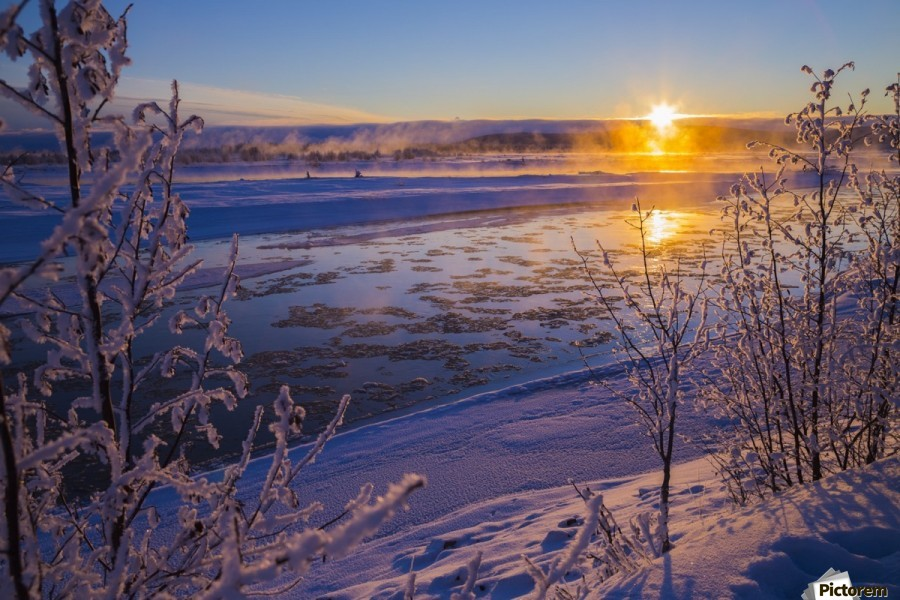 Ice flows in the Tanana River at sunset during freeze up in early winter; Alaska, United States of America  Print