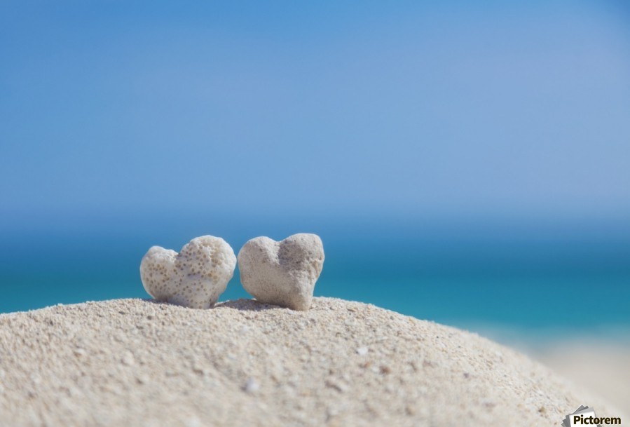 Two white heart shaped coral rocks placed together on sand at the beach; Honolulu, Oahu, Hawaii, United States of America  Print