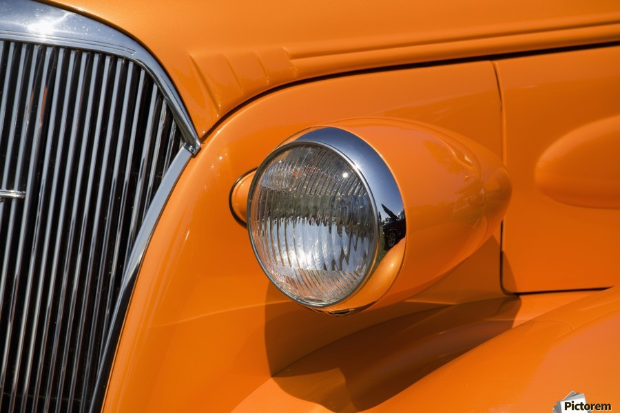 Orange Painted Vintage Car's Headlight And Front Grill; Port Colborne, Ontario, Canada  Print