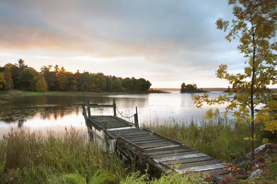 A Dock On A Lake At Sunrise Near Wawa; Ontario, Canada  Print