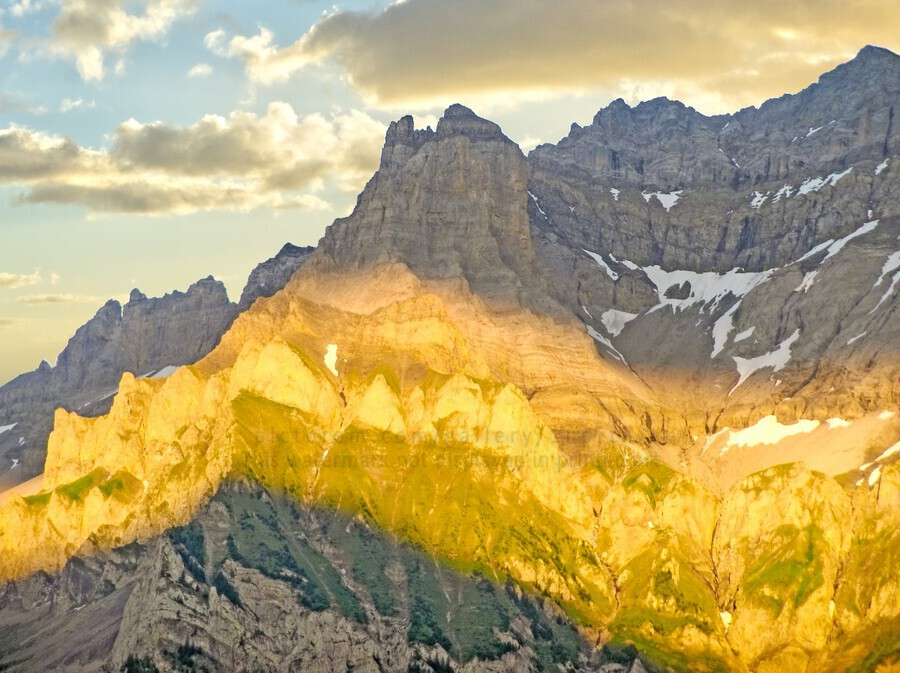 Golden Rays of the Sun Across the Swiss Alps  Print