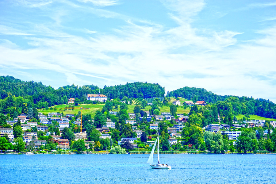Sailboat On Lake Lucerne with Alpine Village in Background  Print