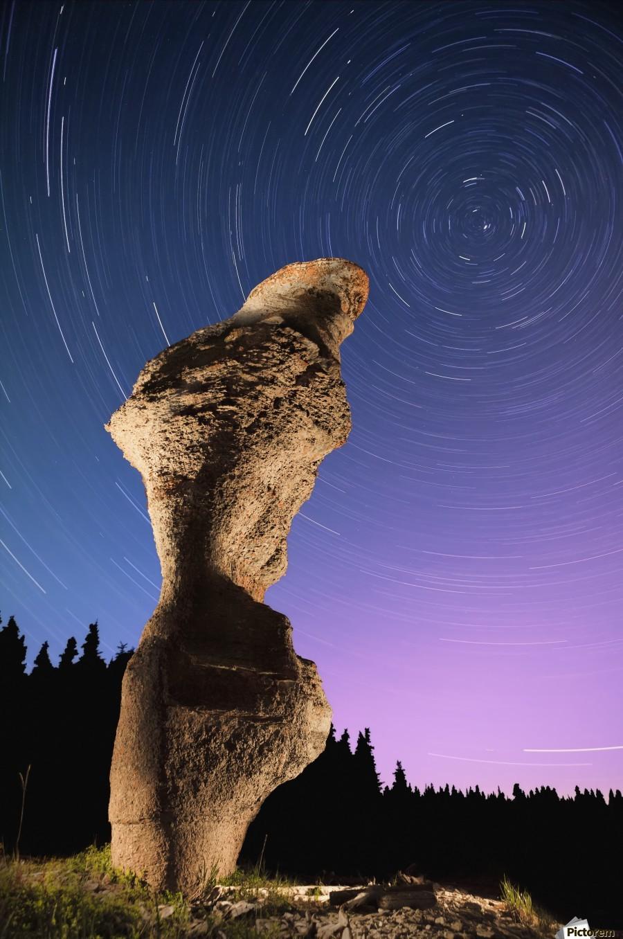 Light painting on monolith and star trails, Anse des Bonnes Femmes at Ile Niapiskau, Mingan Archipelago National Park Reserve of Canada, Cote-Nord, Duplessis region; Quebec, Canada  Print