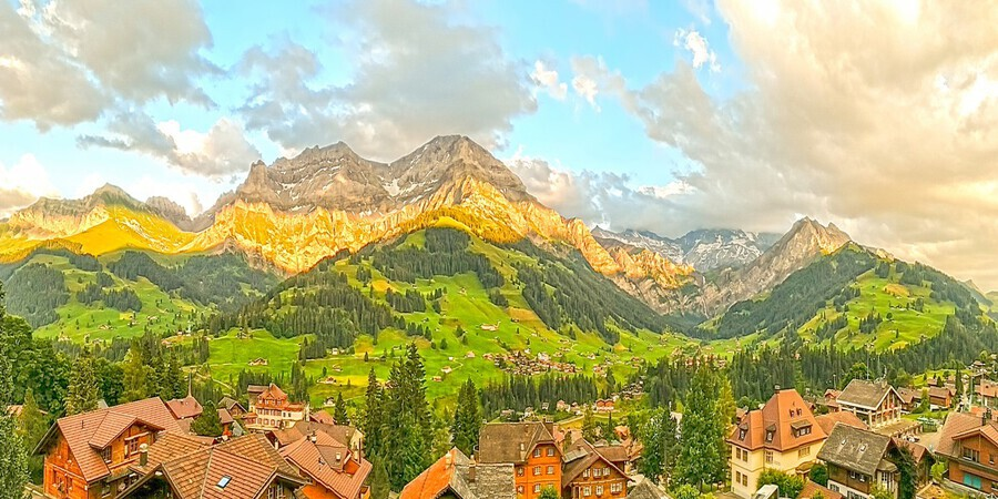 Golden Rays Across The Bernese Highlands in Switzerland Panorama with Engstligen Falls  Print