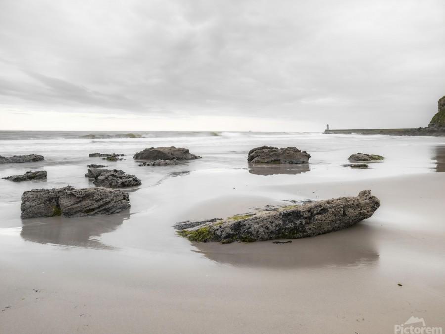 Rocks on a sandy beach  Print