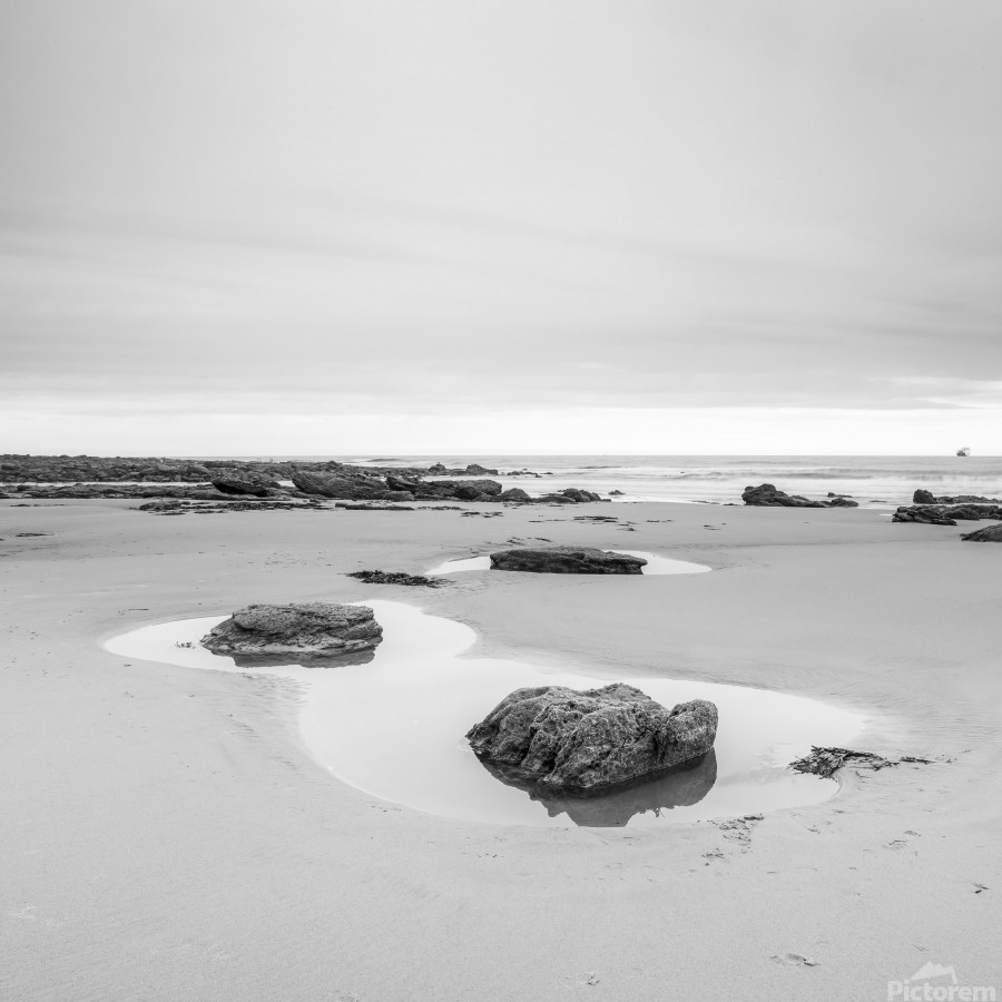 Rock pools on a sandy beach  Print