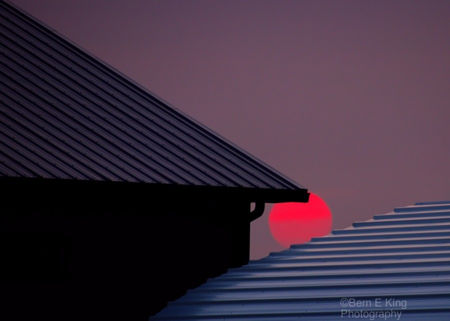 Smokey Sunset and Steel Roofs  Print