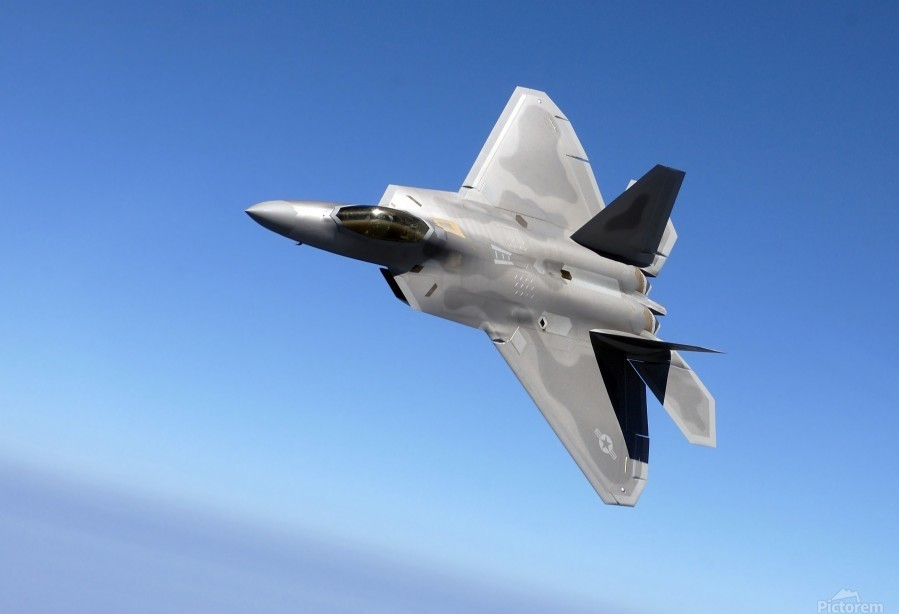 An F-A-22 Raptor banks during a training sortie.  Print