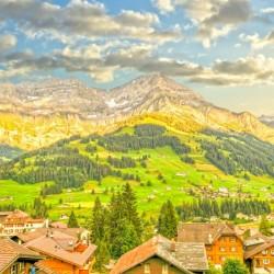 Golden Rays of the Sun in the Mountains Alpine Village Switzerland