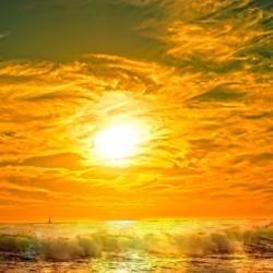 Wild Waves Break as the Sun Sets over Catalina Island in Newport Beach California