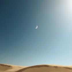 Moons over dunes