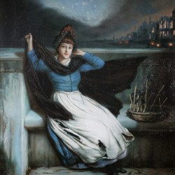 A woman in a blue dress at the edge of a city