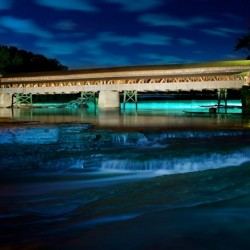Night image of Harpersfield Covered Bridge over Grand River Ohio