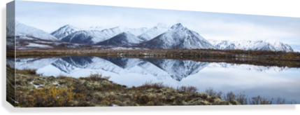 Mount Adney reflected in a pond along the Dempster Highway in the northern Yukon; Yukon, Canada  Canvas Print