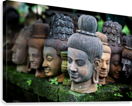 Heads of statues of Buddha are stacked in a terra-cotta factory; Chiang Mai, Thailand  Canvas Print