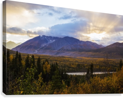 Autumn sunset overlooking the area known as 'Black Rapids' in the Alaska Range along the Richardson Highway; Alaska, United States of America  Canvas Print