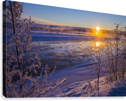 Ice flows in the Tanana River at sunset during freeze up in early winter; Alaska, United States of America  Canvas Print
