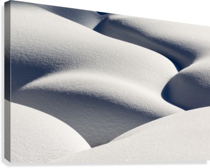 Artistic montage of snow contouring a creek bed with graphic designs of curving highlights and shadows; Lake Louise, Alberta, Canada  Canvas Print