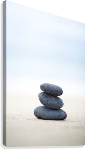 STACK OF STONES ON SAND, SELECTIVE FOCUS. PACIFICSTOCK  Canvas Print