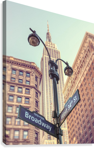 Street lamp and street signs with Empire State building in background - New York  Canvas Print