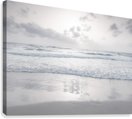 Tranquil beach with cloudscapes  Canvas Print