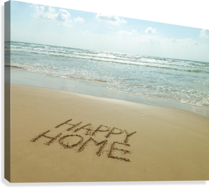 Happy Home written in sand on the beach  Canvas Print