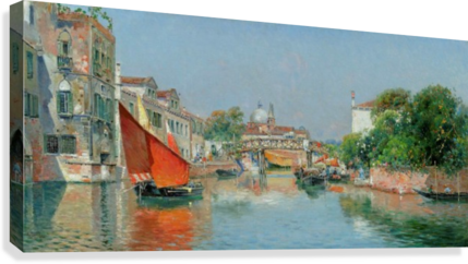 Boats along a Venetian canal  Canvas Print