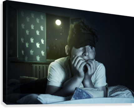 scared and sleepless boy chewing fingernails Canvas print