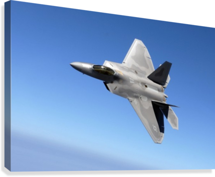 An F-A-22 Raptor banks during a training sortie.  Canvas Print
