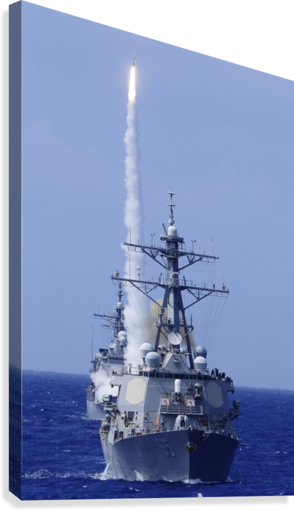 The guided-missile destroyer USS Benfold fires a surface-to-air missile off the coast of Hawaii.  Canvas Print